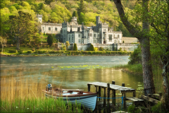 Kylemore Abbey with lake and fishing boat