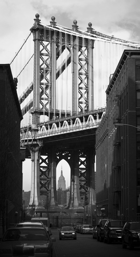 A view of the manhattan bridge from front st. in DUMBO (down under the manhattan bridge overpass) brooklyn. This photograph was taken from the vantage point popularized by the iconic film poster for 'Once Upon a Time in America'.