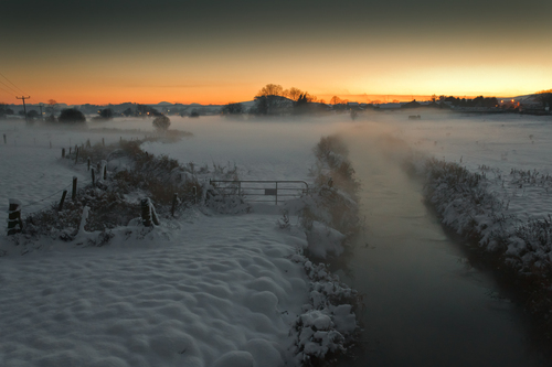 Mist hangs over a snow covered field outside Drumaness, Co.Down.