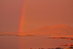 After a heavy summer thunder storm, the rainbow appeared in the sunset.