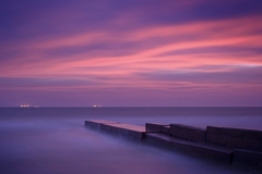 Long exposure shot of one of Odessa's piers during sunrise.