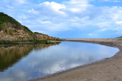 Potters river runs into the sea at Brittas Bay, Co Wicklow
