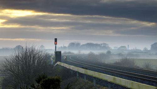 The empty railway lines of the Dublin - Cork Railway, the Curragh, Co Kildare, Ireland.