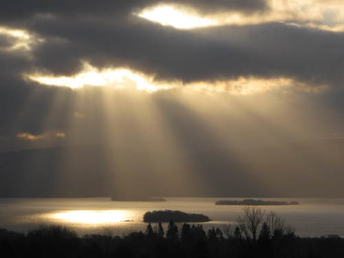 Where there's  a will there's a way.  Light bursting through the dark clouds that descend over the islands of Lough Derg.