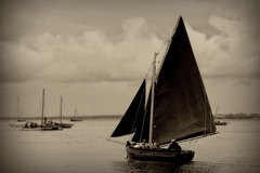 a traditional galway hooker sailing in kinvara harbour