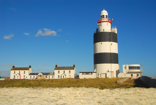 Hook Head lighthouse, with its characteristic black and white stripes, is thought to be one of the oldest operational lighthouses in the world. A sixth century Welsh monk is reputed to have established the first light on Hook Head such was his dismay at discovering the bodies of shipwrecked sailors on the rocks.