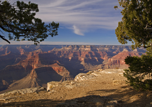 Evening light bathes the Grand Canyon in a warm glow as seen from the South Rim at Hopi Point.