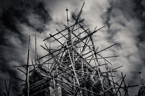 Bamboo scaffolding around a temple in bangkok.