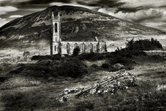 The old Church Dunlewy with Mt Errigal .The haunted walls are still standing. The white marble of which it was built was quarried just down the road a few hundred yards, the marble glows in the soft Irish light. Adding to the mystery, few will venture near the old church after dark for it is said to be haunted, the mute and haunting atmosphere is inescapable.