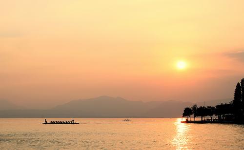 Watching the sun go down at Bardolino Lake Garda Italy.