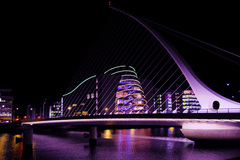 Nighttime view of the Samuel Beckett Bridge in Dublin, in front of the Convention Centre.