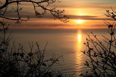 The sun rising over the Irish Sea and Killiney, Bay, Dublin, Ireland, Feb. 2012.