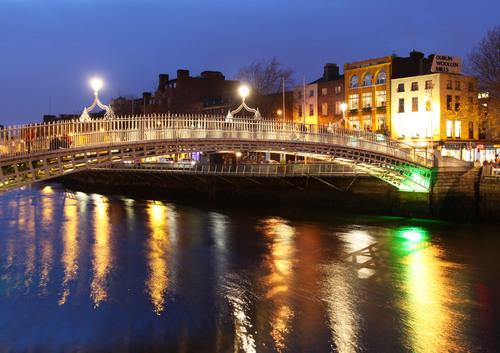 Nighttime reflections at Ha'penny Bridge, Dublin, Ireland, Nov. 2011.