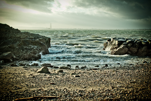 This is a photo I took of a little inlet on Howth Head.  You can see that it is looking out towards the two smoke stacks on the Coast Road in Sandymount.