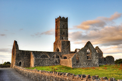 A Franciscan friary, founded in 1414, by William O'Kelly, Lord of Ui Maine. Although in ruins it is well maintained by the OPW. The abbey is the burial place for the O'Kelly sept, whose family crest can be seen on some of the headstones