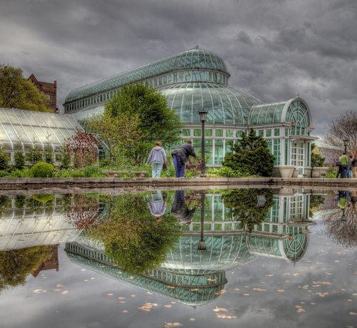 HDR reflection from the entrance of the botanic gardens in new york. No tripod so i was happy with the final shot - pity there was people in the way though!