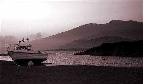 This little boat waits patiently for the tide to come in on Cappagh beach as the sunrises.