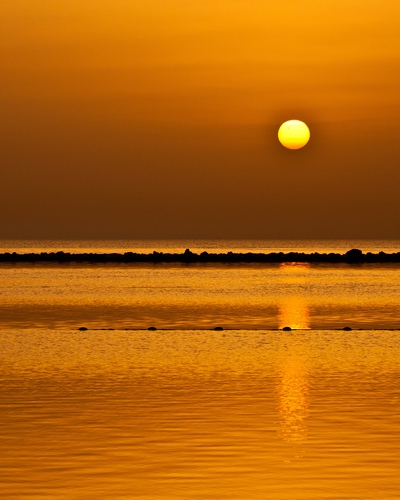 The transit of Venus taken at dawn on June 6, 2012 from Amwaj Island, Bahrain. Venus is visible as a small black dot passing across the face of the Sun. This is a rare occurence and won't happen again until 2117.