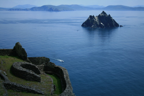 Skellig Michael, or Great Skellig, is an island (the larger of the two Skellig Islands) in the Atlantic Ocean, 11.6km west of the Iveragh Peninsula in County Kerry, Ireland. A Christian monastery was founded on the island at some point between the 6th and 8th century, and was continuously occupied until its abandonment in the late 12th century. The remains of this monastery, along with most of the island itself, were inscribed on the UNESCO World Heritage List in 1996