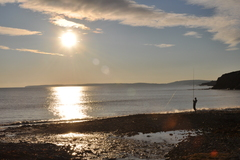 Boy fishing on Inch Strand