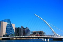 A Look towards the Samuel Becket bridge and the National Conference centre with the Liffey as its lead heading towards the mouth of Dublin Bay.
