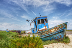 """ New Efigenia "" is the name of this old boat lying in a portuguese beach called Carrasqueira near the city of Alcacer do Sal."