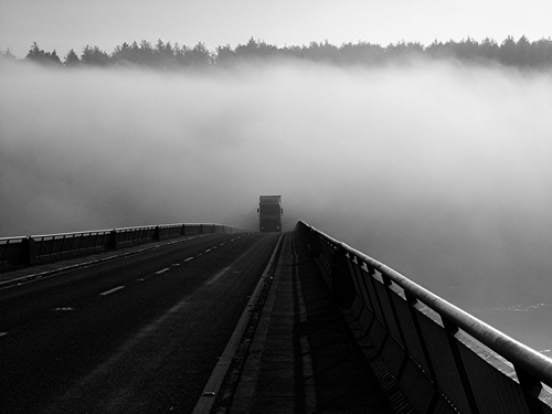 I was standing on Youghal Bridge trying to get something of the mist as it crept over. I noticed the truck entering the mist further round the bend and decided to wait and get it as it came out.