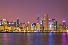 Chicago by night during breat cancer awarness month