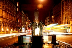 Long exposure night shot of the Edward Delaney sculpture on Dame Street.