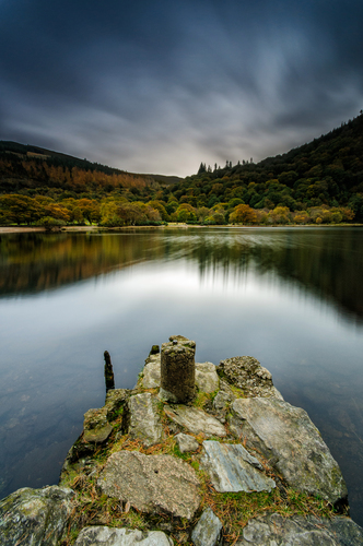 Glen of two lakes. Glacial valley in Co.Wicklow, Ireland.  It is renowned for its Early Medieval monastic settlement founded in the 6th century by St Kevin, a hermit priest, and partly destroyed in 1398 by English troops.