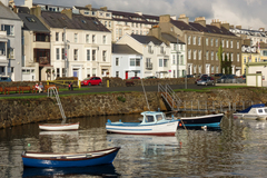 Portrush is a pretty seaside holiday town that is located along the very scenic Antrim Coastline in Northern Ireland.  The town includes a picturesque harbour, a small section of which is shown here.