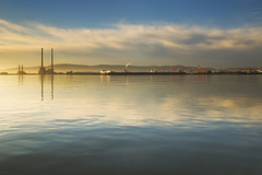 The iconic towers of the Poolbeg power station taken from the Clontarf side of Dublin Bay.