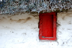 An old shutter on a window of an old thatched home in Glengrant, Carrigeen, Mooncoin, Co. Kilkenny, Ireland.