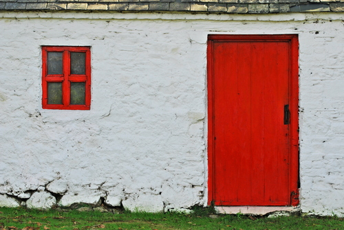 An old red window and matching red door, seen in a little cottage near Jack Meades pub, Co. Waterford.