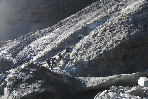 Trekkers making their way up the 12km long Franz Josef Glacier.