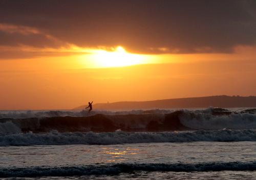 sunset surfing new years day garettstown cork ireland