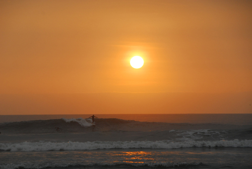 Cathing the last waves of the evening in Huanchaco.