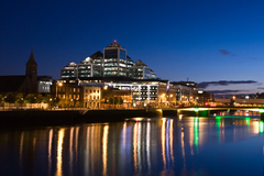 The lights from the Ulster Bank building reflect on the Liffey
