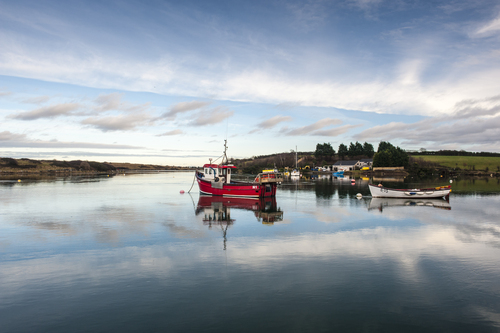 Fishing trawler in Whiterock Bay on a calm January day.