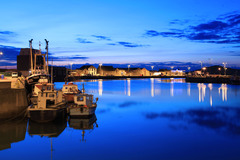 Summer evening reflections, Howth harbour, Dublin.