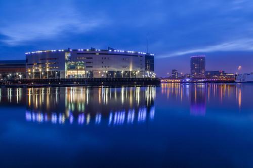 Odyssey Arena reflection in river Lagan, Titanic Quarter, Belfast.