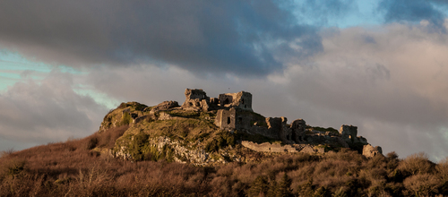 The Rock of Dunamaise warmly lit by low winter sunshine