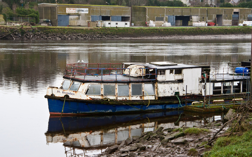 Old unused barge on the banks of the barrow at New Ross Co Wexford