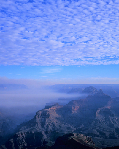 Misty morning view from of the Grand Canyon from Mather Point on the South Rim of Grand Canyon National Park.