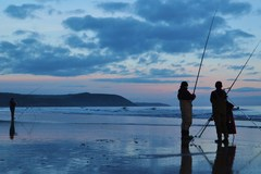 A couple of Anglers beach fishing on the strand, Youghal, Co. Cork, Ireland