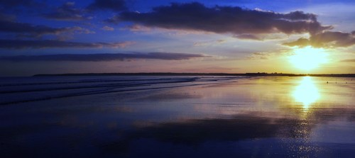 The sun setting over Youghal strand, Co. Cork, Ireland.