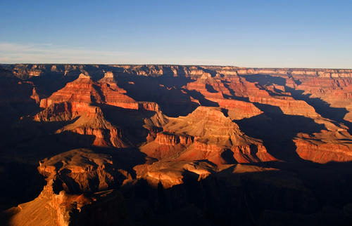 The Grand Canyon glows in the evening light as seen from Hopi Point on the South Rim of Grand Canyon National Park in northern Arizona.