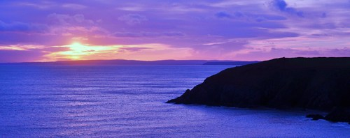 The Sun sets over the Copper Coast in the vicinity of Annestown Beach, Co. Waterford, Ireland.