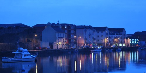 Just some of the boats moored for the night at Dungarvan Bay  as Night Falls.  Dungarvan, Co. Waterford, Ireland.