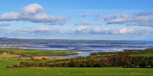 This view of Dungarvan town and bay is taken from just outside its environs on the Youghal Road.